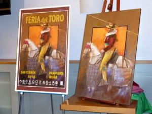 El cartel anunciador de la feria junto a la obra original de Arnás.
